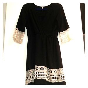 Black dress with white netted sleeves and bottom